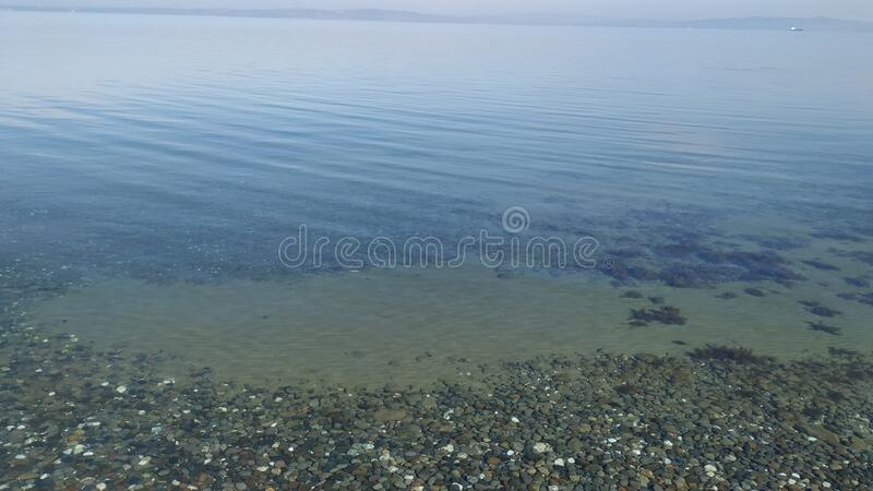 Walking on a calm sea shore stock images