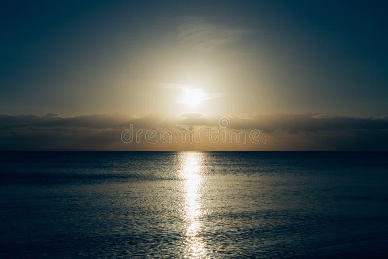 Calm Sea With Sun Setting Photo stock image