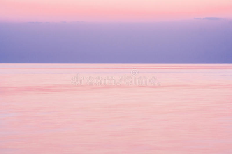 Calm on the sea after sunset. In the summer evening royalty free stock photo