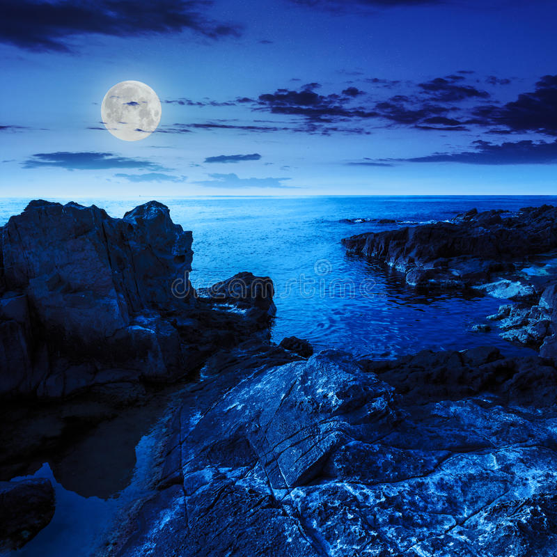 Calm Sea Wave Touches Boulders At Night Stock Image