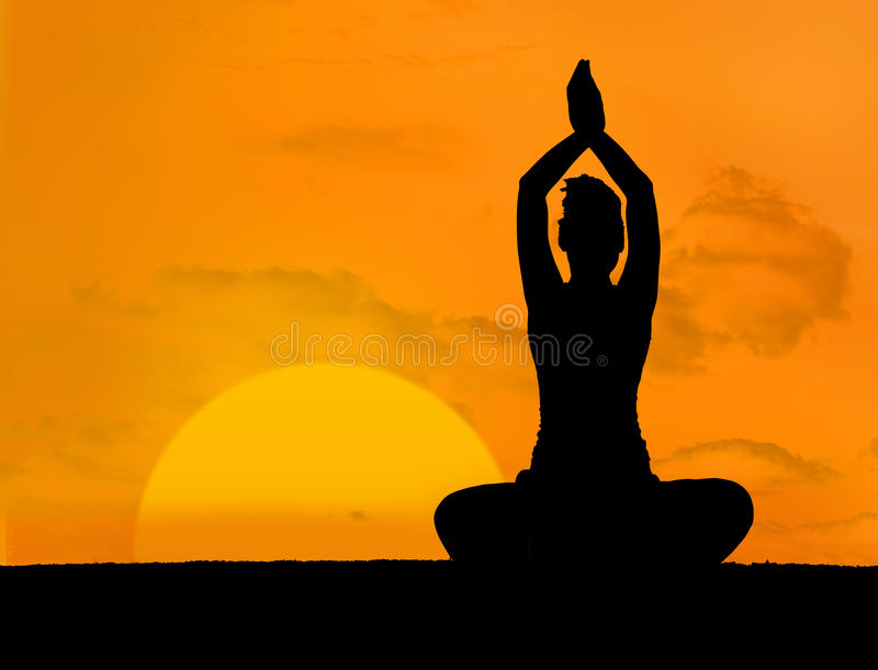 Calm Silhouette Of Woman Doing Yoga Stock Photography