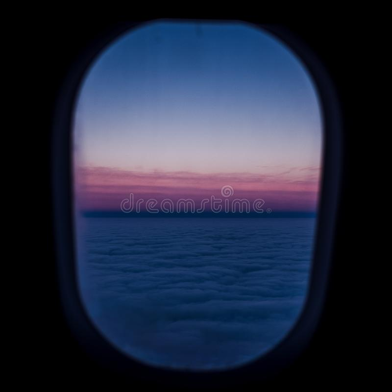 Calm and Sleepy Mood in Air View sunset from Airplane Window at Sunset Dark Atmosphere Travel Concept.  stock photo