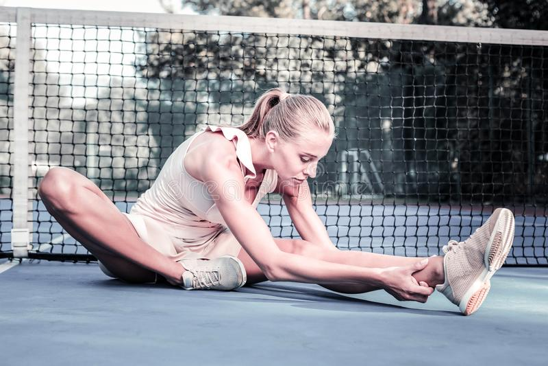 Calm successful female player avoiding sport traumas royalty free stock image