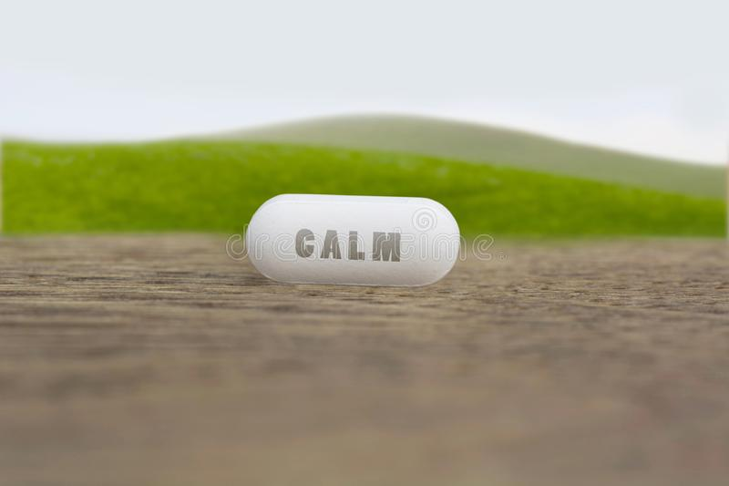 Calm on the table. Calm written on a medical pill stock images