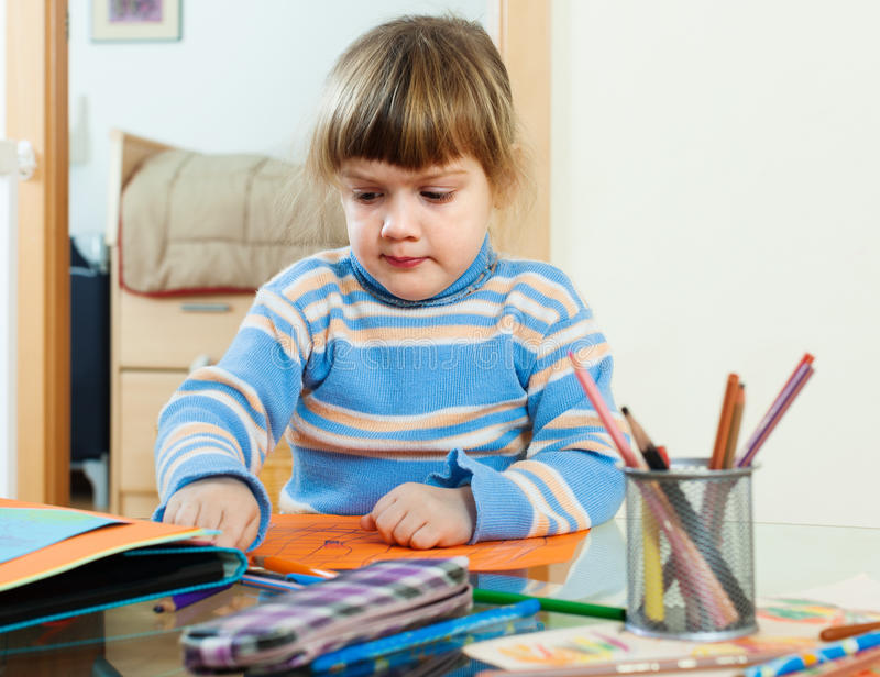 Calm three year child sketching on paper royalty free stock photos