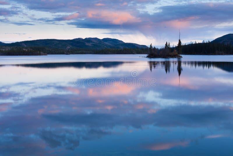Calm Twin Lakes at Sunset, Yukon Territory, Canada royalty free stock image