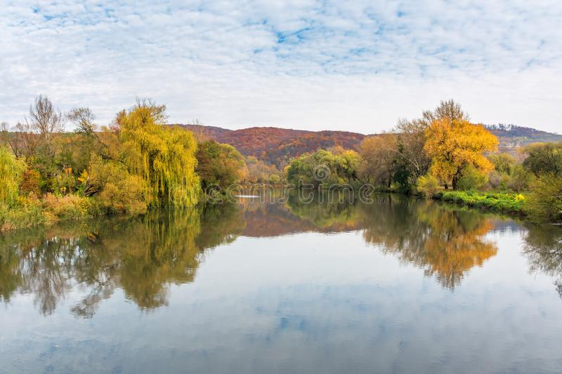 Calm water surface of the mountain river in autumn stock photos