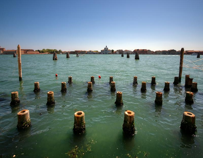 Calm water in the venetian lagoon. View of Judecca. Fireflies in the water. Italy. Venice royalty free stock photo