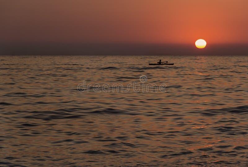 Calm waters of the Aegean, boat on sunset background, minimalism, background, Turkey. Oludeniz stock photography