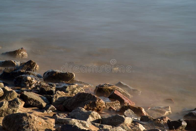 Calm waves on the sand coast stock photo