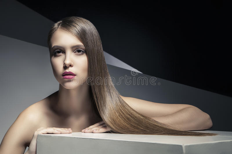 Calm young woman with shiny hair looking away royalty free stock photos