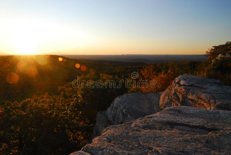 Sunset Upstate New York during the autumn. A calming sunset over a cliff face in upstate New York in the fall stock photography