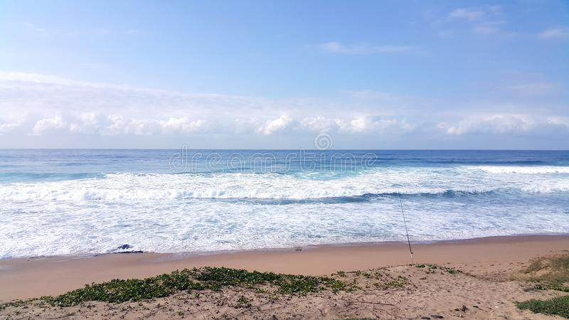 Calming view of beach and waves in South Africa. Calming view of beach and waves in Umkomaas in South Africa royalty free stock photos