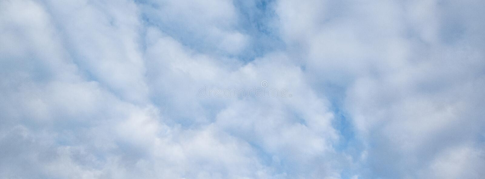 Calming White Clouds and Blue Sky stock image