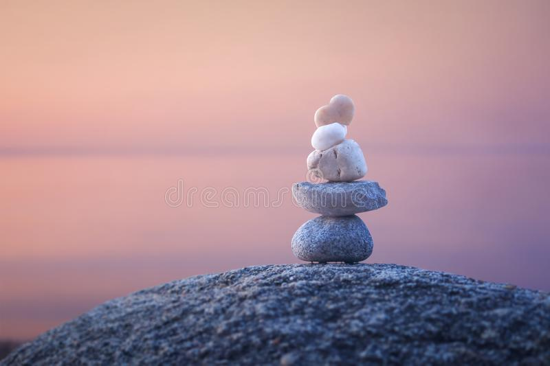 Calming zen rock stack by a lake. Calming zen rock stack in the water of a lake royalty free stock photos
