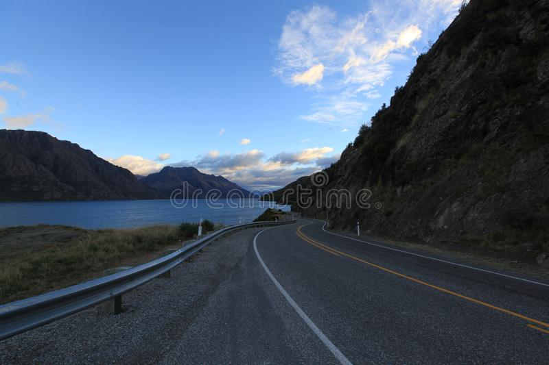 Calmly on the road. In morning with mountain and blue sky background in newzealand royalty free stock images