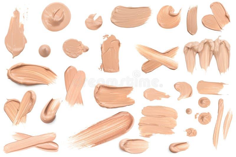 Calomnie beige l?g?re de maquillage de base cr?meuse d'isolement sur le fond blanc image stock