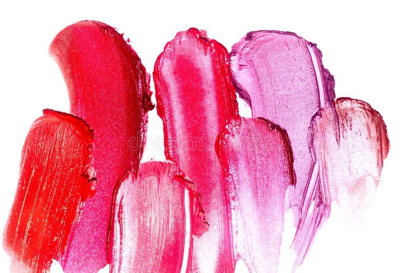 Calomnie colorée de tache de rouge à lèvres d'isolement sur le fond blanc r photographie stock