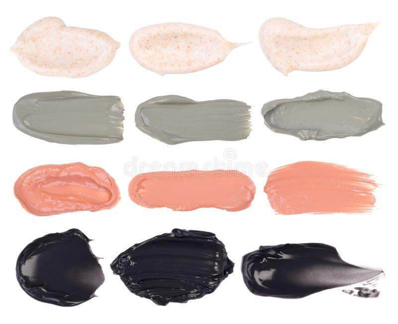 Calomnies cosmétiques de masques d'isolement sur le fond blanc photographie stock