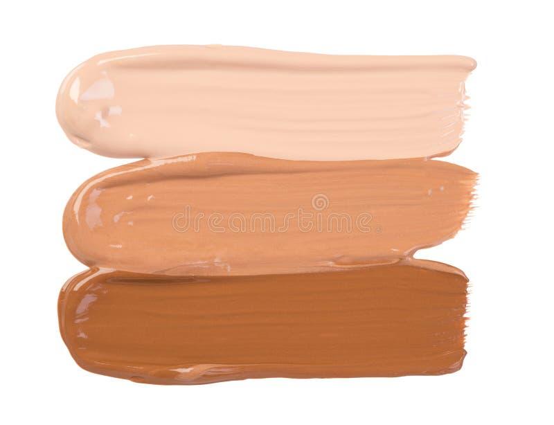 Calomnies de base de maquillage d'isolement sur le fond blanc image stock