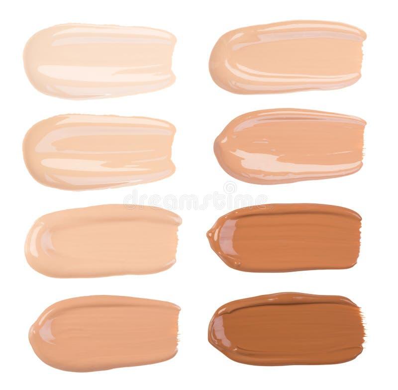 Calomnies de base de maquillage d'isolement sur le fond blanc images stock