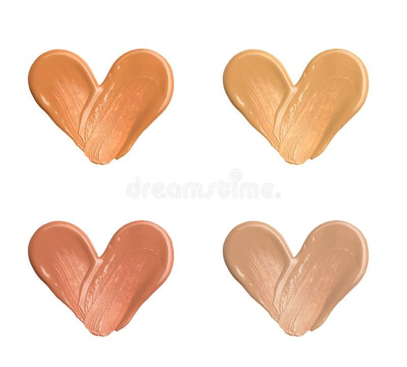 Calomnies de base pour le visage Une calomnie de rouge à lèvres Calomnie cosmétique de liquide D'isolement sur le fond blanc photographie stock