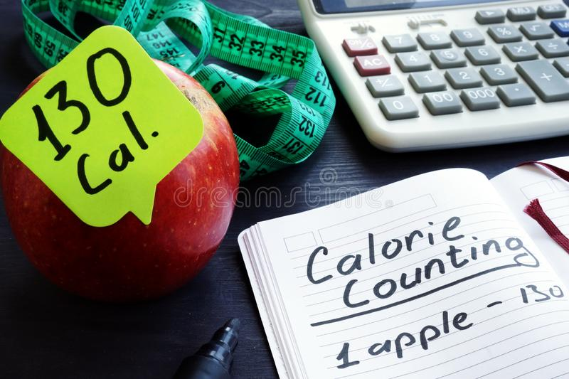 Calorie count. Apple and among calories. Calorie count concept. Apple and among calories royalty free stock image