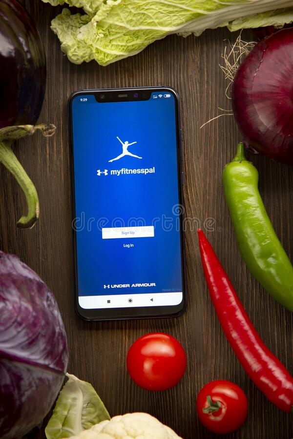 Free Calorie Counter - MyFitnessPal Mobile App Logo On Smartphone. Diet Plan On Tablet Pc And Vegetables. Belgorod , Russia - AUG, 2, Royalty Free Stock Photography - 193044557