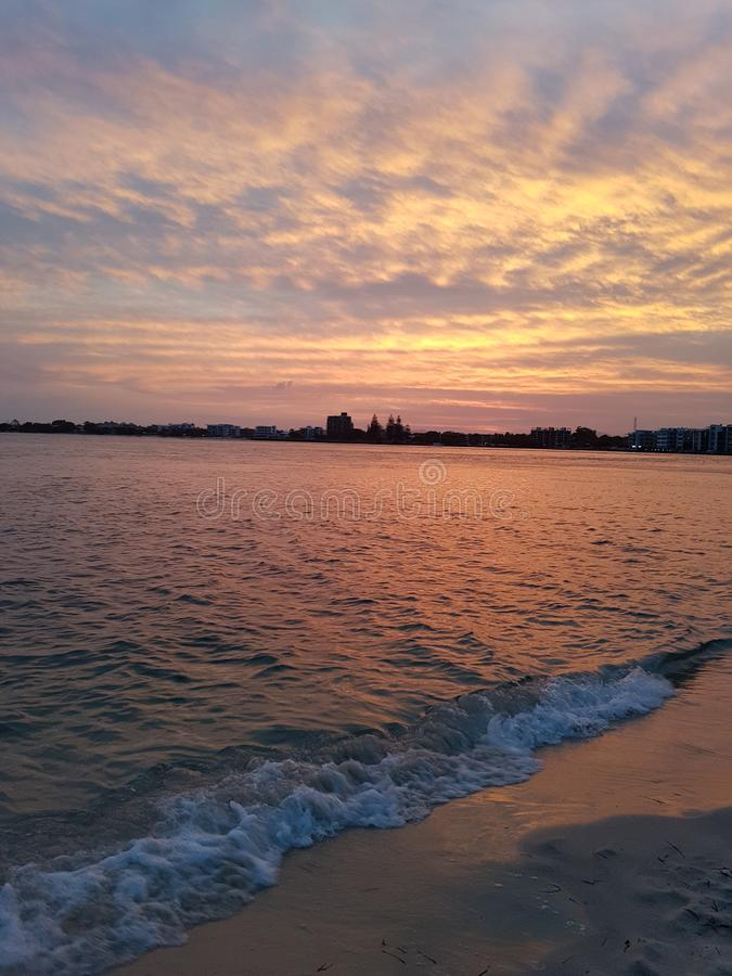 Caloundra sunset shores froth on the sand stock photography