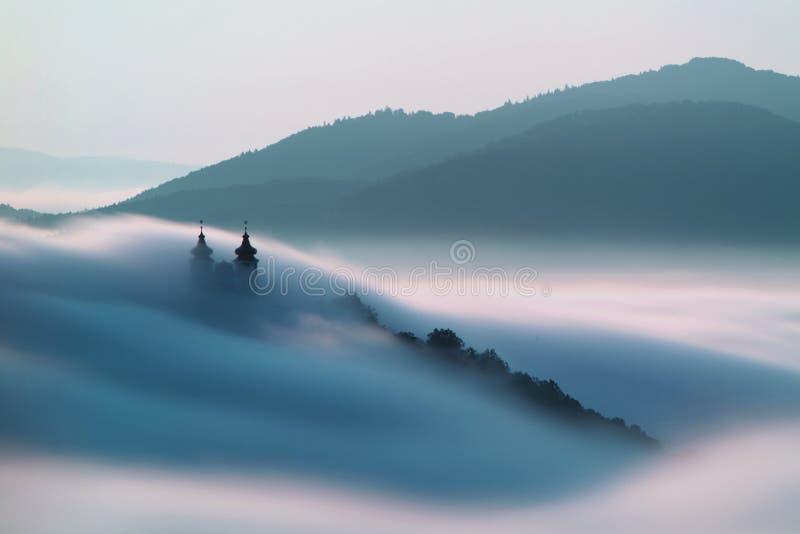 Calvary over clouds in Banska Stiavnica, Slovakia royalty free stock photos