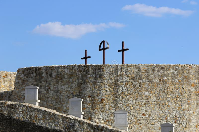 Calvary. With a small monuments of every stations of the cross and 3 crucifixes at the top of the royalty free stock photo