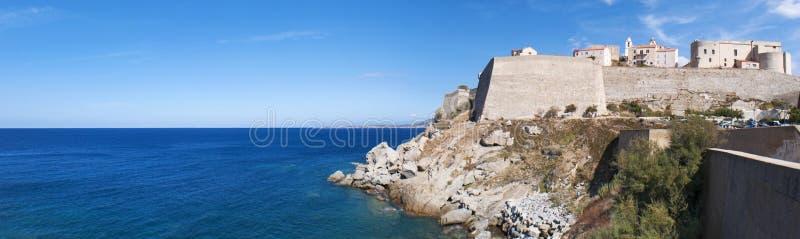 Calvi, Citadel, beach, ancient walls, marina, sailboats, skyline, Corsica, Corse, France, Europe, island. Corsica, 03/09/2017: the Mediterranean Sea and view of stock image