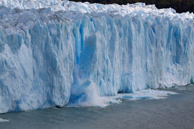 Calving glacier. Perito Moreno glacier calves with breaking ice mass stock photo