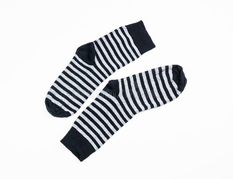 Calzino, paia in bianco e grige usate della banda dei calzini isolati fotografie stock