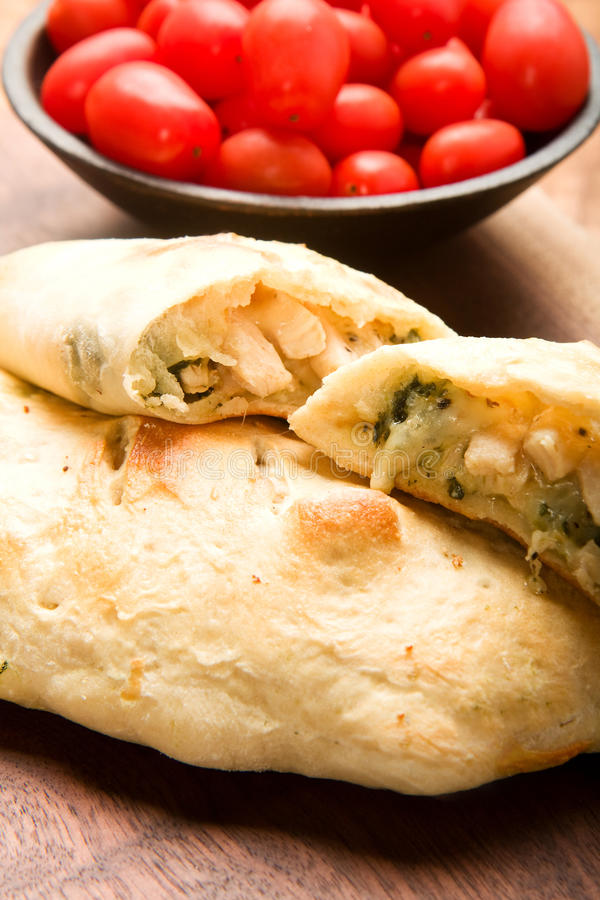 Calzone. Chicken, Spinach, and Basil Calzone with smoked Mozzarella royalty free stock photo
