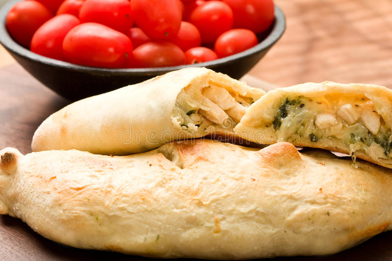 Calzone. A Chicken, Spinach and Basil Calzone with smoked Mozzarella stock photos