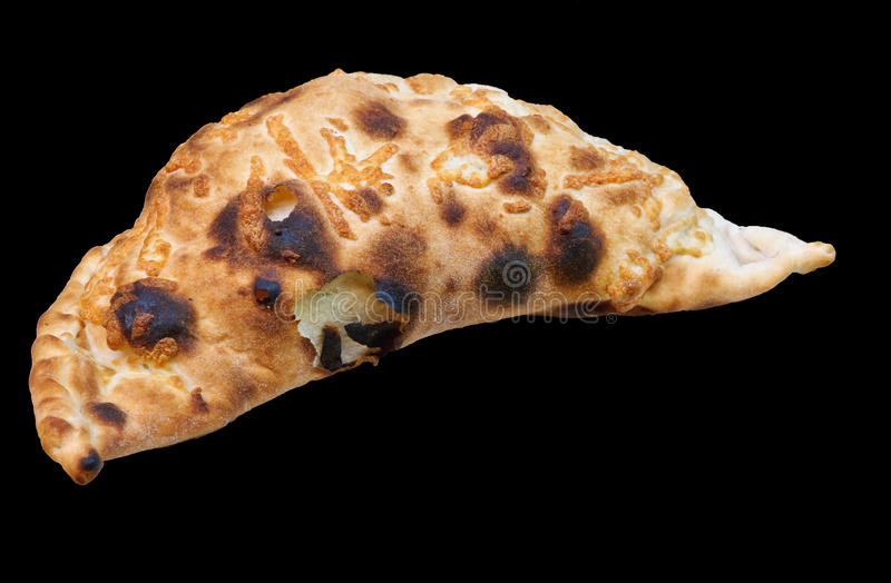 Calzone. Traditional Italian calzone isolated on black royalty free stock photography