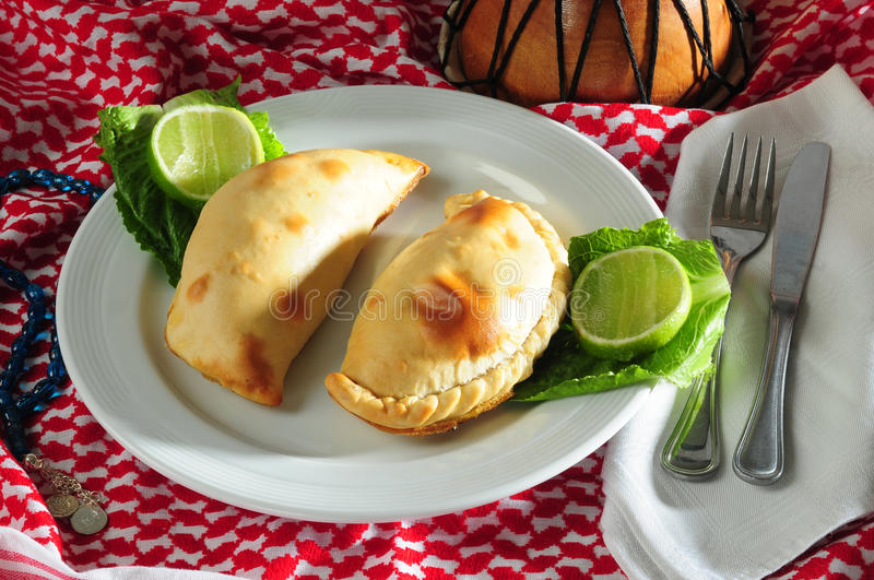 Calzone. Backed calzone in a plate with vegetables stock photos