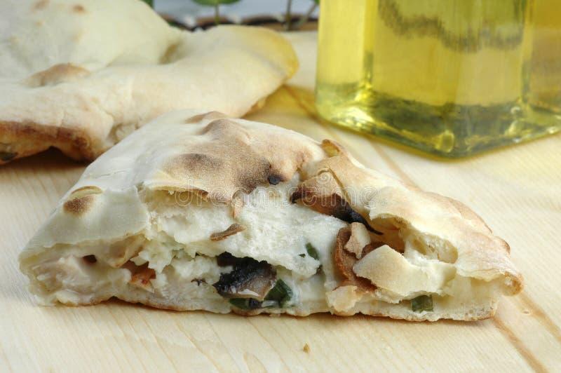 Calzone. Fresh baked cheese and mushroom calzone royalty free stock photos