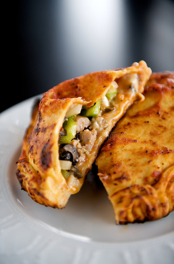 Calzone. Image of calzone with meats and vegetables royalty free stock photography