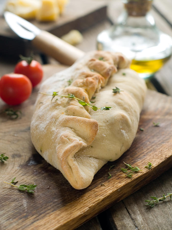 Calzone pizza. On a wooden table, selective focus stock image