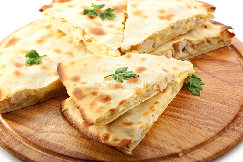 Calzone. Pizza Calzone with Chicken on Wooden Tray royalty free stock images