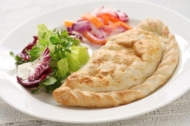Calzone pizza, italian food. Calzone, folded stuffed pizza, italian food stock photo