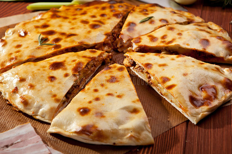 Calzone. Pizza Calzone with Minced Meat and Onions royalty free stock image