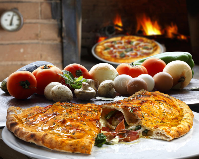 Calzone. Pizza with vegetables roasted in the wood oven stock image