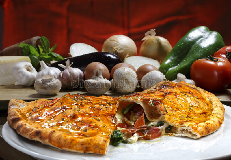 Calzone. Pizza with vegetables roasted in the wood oven royalty free stock photo