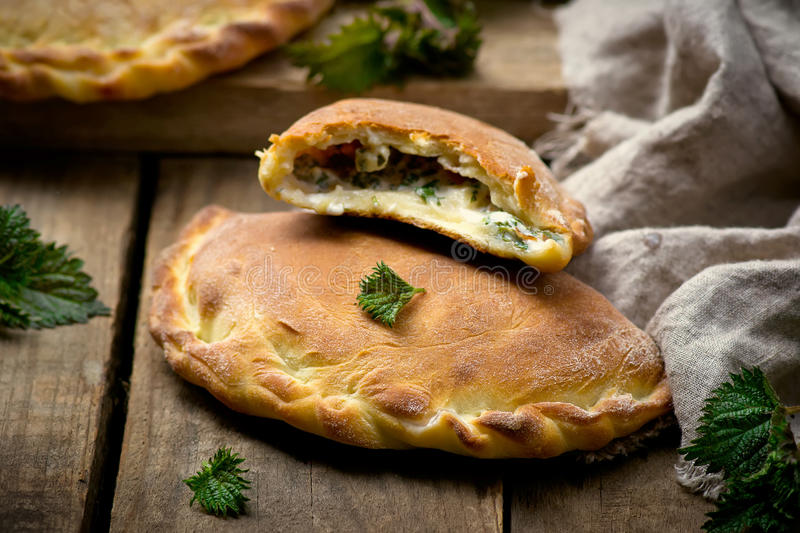 Calzone with ricotta and nettle. Style rustic. selective focus royalty free stock photo