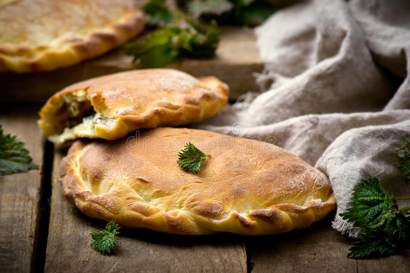Calzone with ricotta and nettle. Style rustic. selective focus stock image