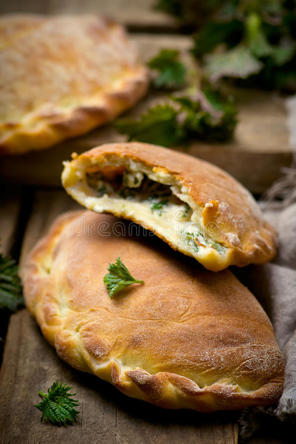 Calzone with ricotta and nettle. Style rustic. selective focus royalty free stock images