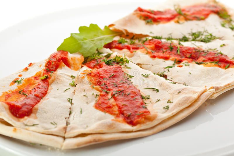 Calzone. Stuffed Pizza with Tomato, Mozzarella and Ham royalty free stock photography